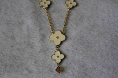 A personal favorite from my Etsy shop https://www.etsy.com/listing/105109588/gold-tone-logo-clover-necklace