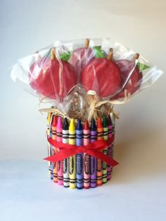 crayons around a jar filled with cookies on sticks or flowers~ maybe put rubber band around instead of gluing; alternatively use pencils or coloring pencils