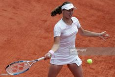 Martina Hingis of Switzerland hits a forehand during a first round match against America's Lisa Raymond during the French Open tennis tournament at Roland Garros stadium in Paris, France, Tuesday, May 30, 2006.  (Photo by Caroline Blumberg/Bloomberg via Getty Images)