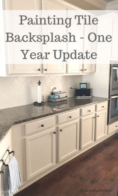 Painting tile backsplash - how to transform your tiled backsplash for very little money and an update on how it stands the test of time. I'll show you how easy I changed the look of our kitchen and what it looks like a year later Painting Tile Backsplash, White Tile Backsplash, Painting Kitchen Cabinets, Kitchen Paint, Kitchen Redo, Kitchen Backsplash, Painting Over Tiles, Kitchen Ideas, Tile Over Tile