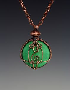 Here is the back side of the Criss Cross wrapped pendant.  I just had some fun with the wire. --Lisa Barth