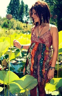 Short dreadlocks! Adorable dress! Lovely garden!  How much more wonderful can a picture be?