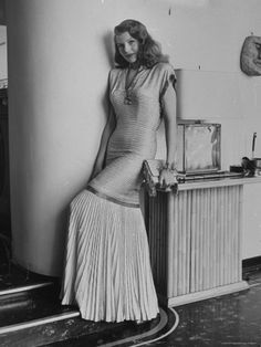Actress Rita Hayworth Clad in Bare Midriff Evening Gown by Designer Jean Louis