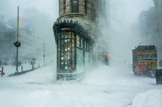 """Michele Palazzo: """"New York City's iconic Flatiron building emerges from the blizzard, like the bow of a giant ship ploughing through the wind and the snow. Taken during the historic coastal storm, Jonas, on 23 January 2016, the photograph went viral during the aftermath of the storm."""""""