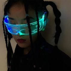 This is the future of looks. Light up your vision with the CYBORG LED Fashion Glasses. The CYBORG shield comes with a variety of RGB lighting mode to fit any style & outfit you're going for! Perfect to pair with any futuristic cyberpunk-related cosplay! Or just anybody and everybody that is looking for something unique and special in the realm of futuristic tech-wardrobe to become reality! Raves, Monster Energy, Cyberpunk Fashion, Futuristic Fashion Editorial, Futuristic Outfits, Futuristic Sunglasses, Dystopian Fashion, Rave Costumes, Neon Party