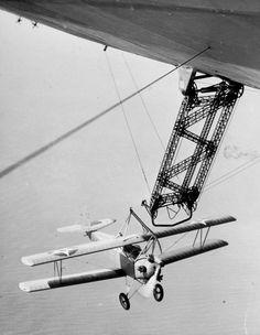 An N2Y-1 pictured about to hook on to the trapeze used for launching and recovering aircraft during evaluation of the equipment on board the rigid airship Los Angeles (ZR 3) at Naval Air Station (NAS) Lakehurst, New Jersey, on August 18, 1931