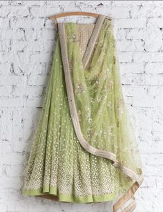 Shop pale green net with precipitant lace work & embroidery work designer lehenga choli online.This set is features a off white blouse in net.It has matching pale green lehenga in net with beautiful embroidery all over and pale green dupatta in brasso Indian Lehenga, Red Lehenga, Anarkali, Bridal Lehenga, Sabyasachi Lehengas, Banarasi Lehenga, Pakistani Dresses, Indian Dresses, Indian Outfits