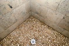Defnitely doing the river rock shower bottom, with a doorless shower
