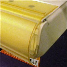 Pushpinned Bullnose with Frontrail Closeup Retail Fixtures, Close Up, Yellow, Color, Colour, Colors, Gold