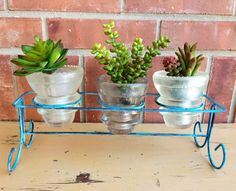 Upcycled - Salvaged - Antique Trio Glass Insulators - Industrial Farmhouse - Candle Holder - Planter - Craft Storage - Funky CHIC. $39.95, via Etsy.