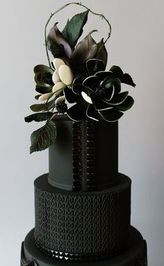 Sleek and modern black on black wedding cake with black sugar flowers made with Satin Ice | Cake Studio