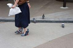Os sapatos viraram pombos