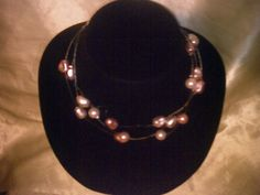 Invisible strand beaded necklace