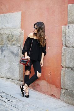 Off the shoulder blouse with ripped denim and lace-up flats.