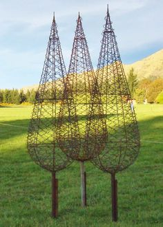 garden sculpture wire trees - I would love to see flowering vines growing on these beautiful sculptured trees.