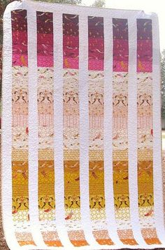 """:: nice idea for a simple baby quilt :: Because the strip width cut crosswise from purchased yardage is about 42"""". Perhaps do bordered elements to make up the width for an adult nap/sofa-size quilt?"""