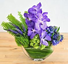 Amethyst, this arrangement from our collection with show-stopping Vanda orchid blossoms dance over fragrant hyacinth, rich purple veronica and a bed of crisp chartreuse greens, collected into a large envelope vase. #florist #floraldesign #floral #flores #flowers #rouvalis #rouvalisflowers #beaconhill #southendboston #bostonflowers #design #flowerarrangement #vanda #nature #igboston #igersboston