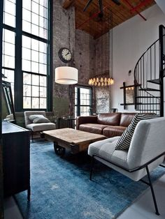 small-industrial-living-room-with-brown-leather-sofa-and-grey-single-sofa Like these chairs