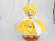 Adorable yellow polka dot dress with embroidery butterfly and flowers on the top and skirt. Plus crystals for a touch of bling. Completely lined.30.00