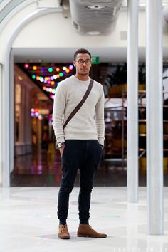 Team a grey crew-neck pullover with navy corduroy jeans to get a laid-back yet stylish look. Tap into some David Gandy dapperness and complete your look with brown suede desert boots. Shop this look for $266: http://lookastic.com/men/looks/crew-neck-sweater-messenger-bag-jeans-desert-boots-socks/5968 — Grey Crew-neck Sweater — Dark Brown Leather Messenger Bag — Navy Corduroy Jeans — Brown Suede Desert Boots — Navy Socks