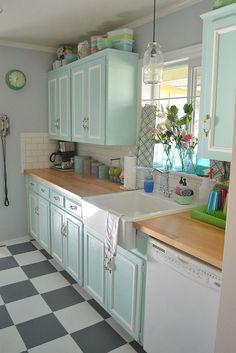 50s kitchen makeover - soft seafoam chalk paint cabinets, Ikea single Domsjo farmhouse sink, butcher block countertops, subway tile backsplash, lots of vintage goodness (including Pyrex, of course!)
