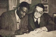 Jackie Robinson signing a minor league contract for the minor league team in Montreal (1945) while Branch Rickey looks on.  Jackie would later be promoted to the Brooklyn Dodgers in 1947 for his rookie season in Major League Baseball.