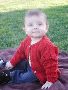 Beautiful red lace hand knit sweater for baby