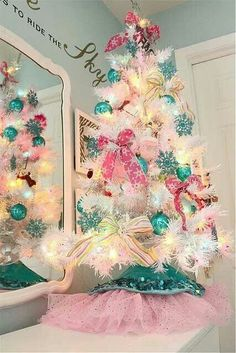 Gorgeous pink and aqua bows on a white Christians tree.