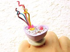 "This is soooo cute! There is a purple heart dish filled with vanilla mousse. There is also a candy shaped like a chick, a strawberry candy and many sprinkles. There are also colorful ""paper"" streamers that come from a kind of Japanese party ""cracker"".    It is on a silver tone adjustable band that will fit most ring sizes. It measures about 4 cm wide.    SouZouCreations' products are made with attention to detail, creativity and long lasting dependability."