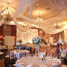 Elegant illuminated ceiling draping by Rachel A. Clingen Wedding Design &…