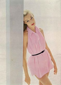 November Vogue 1953  Model is wearing a pink swimming shirt by Carolyn Schnurer, photographed by John Rawlings.
