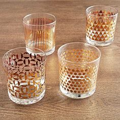 "Metallic Print Glassware Set #westelm $34 Modern upgrade for the Old Fashioned. Featuring four distinct designs, the Metallic Print Glassware set is sure to catch the eye at your next get-together. Available with either silver or gold detailing, they complement any style bar.  3.4""diam. x 3.5""h.4 old fashioned glasses"