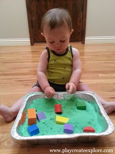 Play Create Explore: Baby Sensory Bin: Colored Sand and Blocks