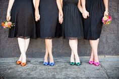 mismatched black dresses and flowers to match shoes