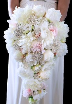 Cascading white and pink peony bouquet with jewels