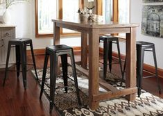 Pinnadel Bar Table, from Jarons Furniture's wide selection of pub tables. Tall tables for your kitchen, den, living room, family room, and more. Visit Jarons showrooms in Bordentown or Lumberton, New Jersey, or browse our selection at Jarons.com