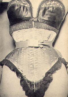 published in John Willie's Bizarre magazine - metal waist cincher