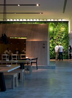The wooden structure in front of the garden serves as a more private eating area.