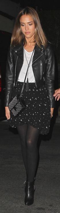 Who made  Jessica Alba's black leather jacket, fringe necklace, and white print handbag?