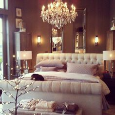 Bedroom - cream, tan, quilted headboard, chandelier, mirrors, lamps. I would add more masculine touches such as leather or cowhide.