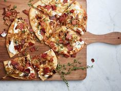 You could caramelize your own onions, but to save time we don't mind using store-bought on our Alsatian pizza with bacon. Get the recipe.