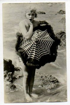 Vintage girl with parasol.