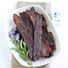 Spicy Teriyaki Beef Jerky (Hang meat strips from toothpicks on your oven rack and cook at 200 degrees for 1 hour and 20 minutes.)