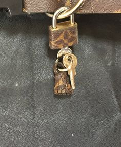 Louis Vuitton 30mm lock upcycle recycled repurposed LV padlock keys mini  tassle by VintageTimeline on Etsy 61abc317e62dc