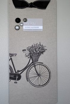 this adorable magnet board is constructed from a solid piece of steel, covered in burlap fabric and finished with a ribbon for hanging. An adorable image has been added to the burlap to give that perfect vintage look.  Fabric Magnet Board 95x20  Bicycle by LivyLouDesigns on Etsy, $24.50