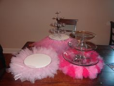 three cake stands with tulle skirts