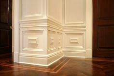 Simply gorgeous.  Tasteful moldings used as base detail.  Beautiful wood floors with trim details.