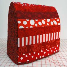 Tutorial: jelly roll KitchenAid mixer cover ... http://mariaelkins.com/index.php/2011/12/tutorial-kitchenaid-cover/