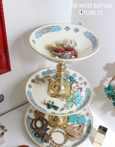 Three Tiered Jewelry Stand from Old China and Candlesticks from thewhitebuffalostylingco.com