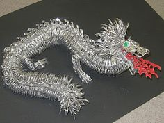 Pop tab dragon sculpture  Hey look what we can do with pop tabs!
